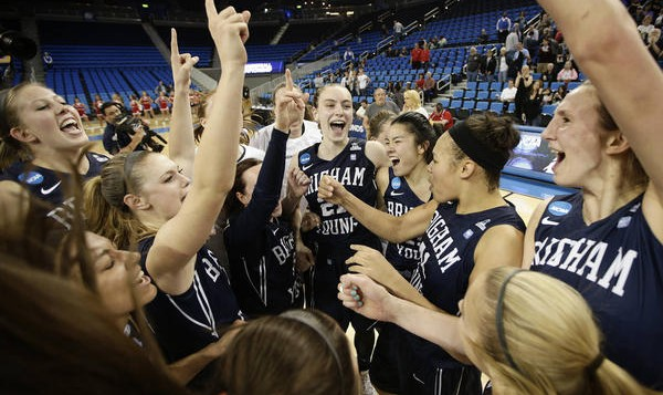 The BYU Lady Cougars Basketball team celebrates a victory