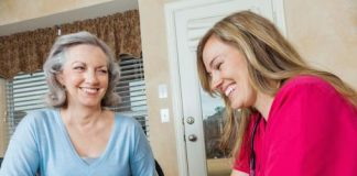 Two women laugh together