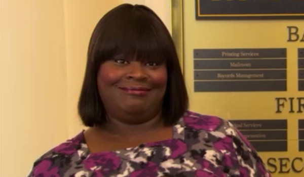 Donna Meagle from Parks and Rec mugs for the camera