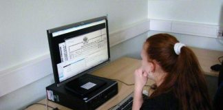 A young woman indexes on her computer