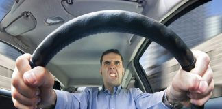 Man driving angrily