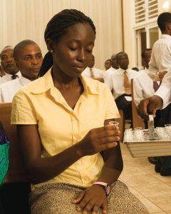 Woman partaking the sacrament