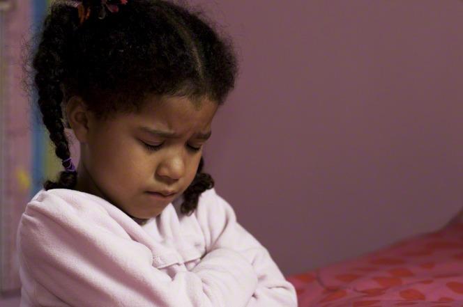 Young Girl kneels in prayer