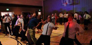 Teenagers line dance
