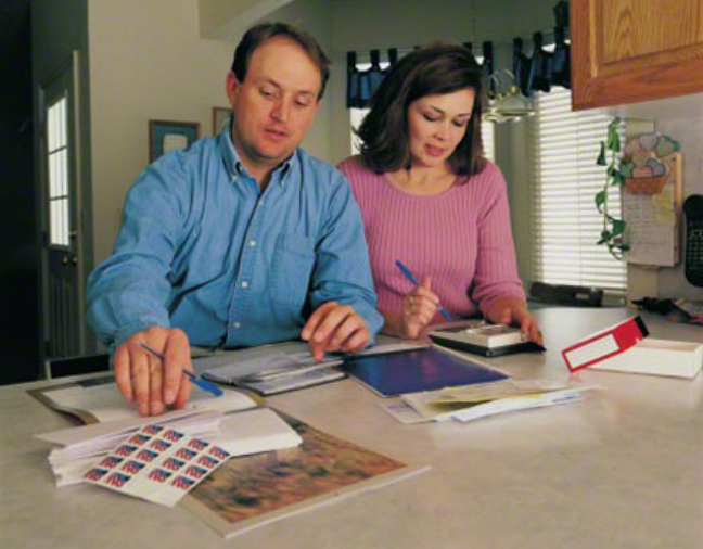 Couple reviewing finances together