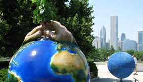 Statue of planting a tree on planet Earth