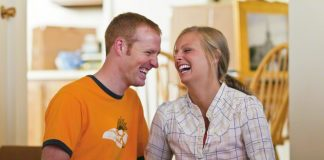 happy young couple in a new house