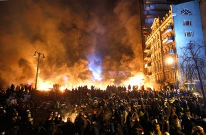 Black smoke rises during the clashes between protesters and police in Kiev