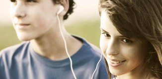 Two teenagers listening to music