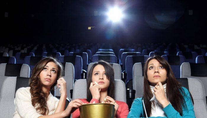 3 women watch a sad movie