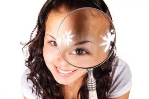 Woman through a magnifying glass