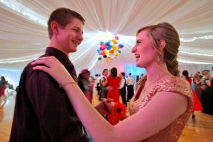 "A couple dances at the ""Mormon Prom"""