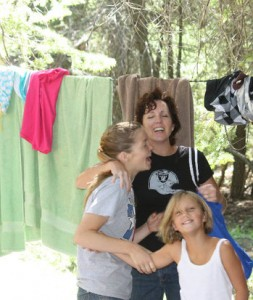 Mother enjoying camping with her daughters
