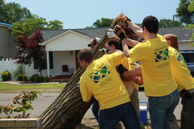 Mormon Help Hands volunteers serving in a neighborhood cleanup