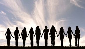 Silhouette of a line of women holding hands