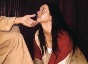 Woman kneeling at Jesus' feet