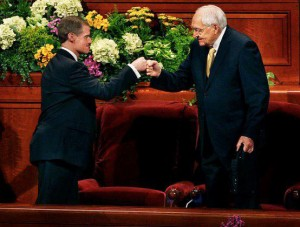 Elder Bednar and Elder Perry fist bumping after General Conference