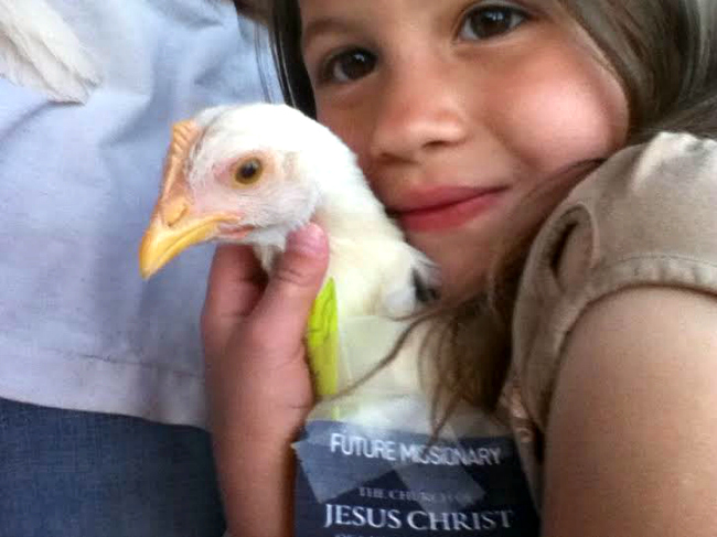 Pet dressed as Mormon missionary with little girl