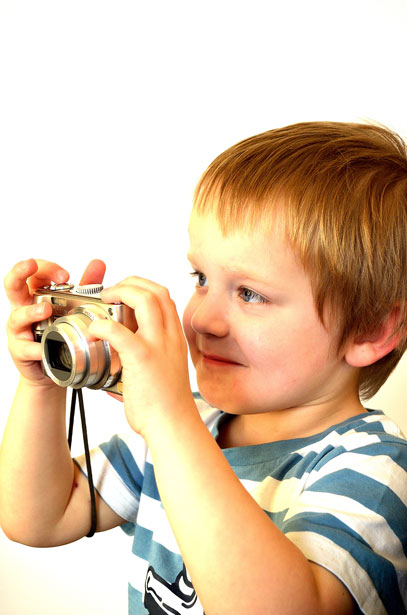 child and a camera