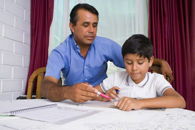 father and son working on homework