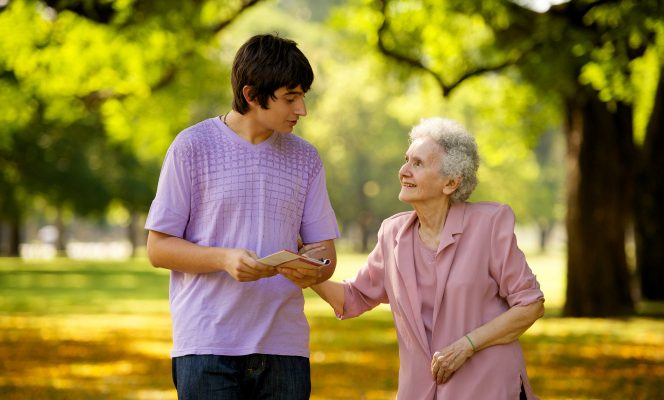 young man and elderly woman