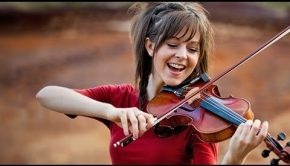 Lindsey Stirling playing violin outdoors
