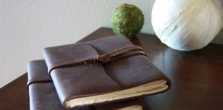 Leather bound journals on a desk