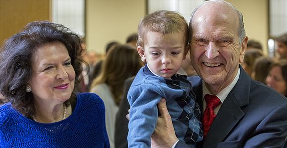 Elder and Sister Nelson visit church members in Brazil.
