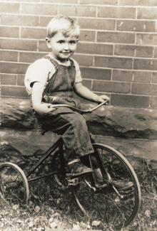 Young Thomas S. Monson riding a tricycle