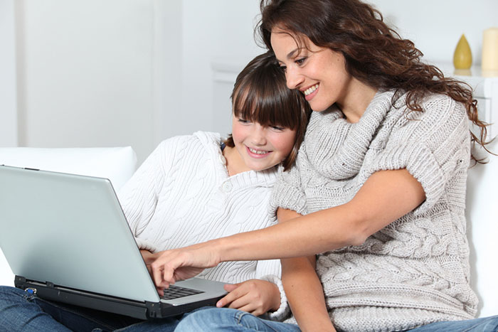 mom and daughter using a laptop computer