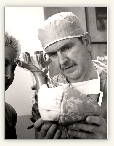 Dr. Nelson examines a model of the human heart