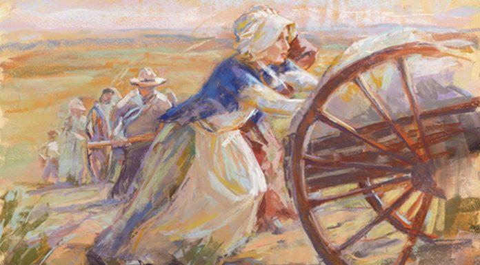 Mormon pioneer woman pushing handcart
