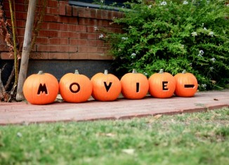 Directions to Halloween Movie Night carved in Pumpkins