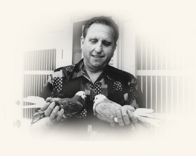 Thomas S. Monson holding two of his pigeons