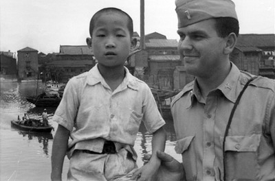 Russell M Nelson and a Korean boy