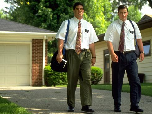 two missionaries walking down the street