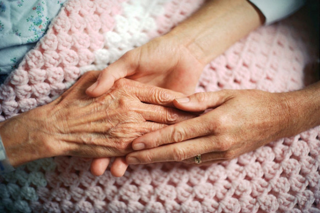 Elderly woman's hands at moment of death