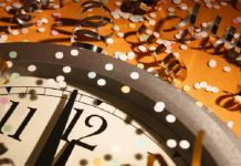 New Years Eve with clock and confetti