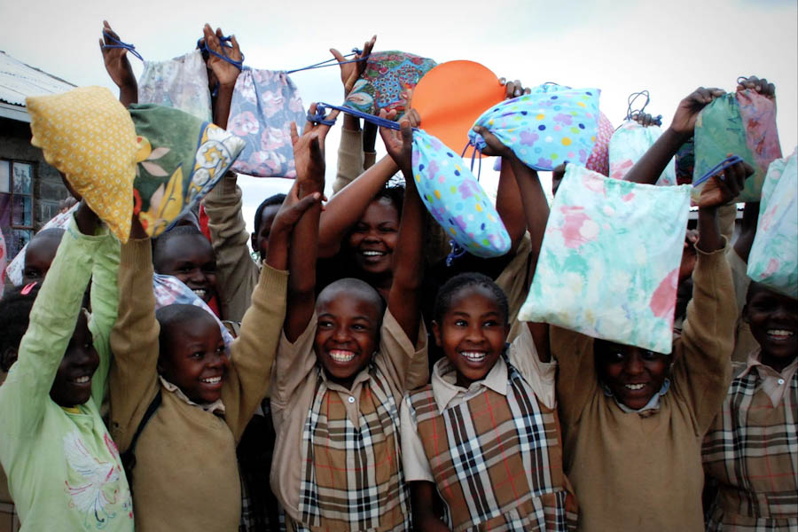 Young women in Kenya happy to receive their Days for Girls kits