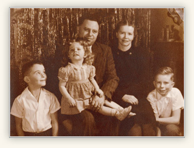 portrait of Quentin L. Cook with parents and siblings