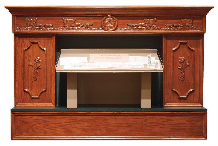 Fire place hand carved by President Packer. Image via LDS.org.