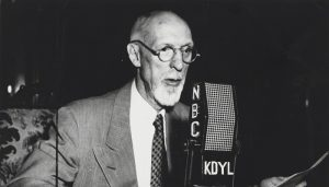 George Albert Smith talks on the microphone