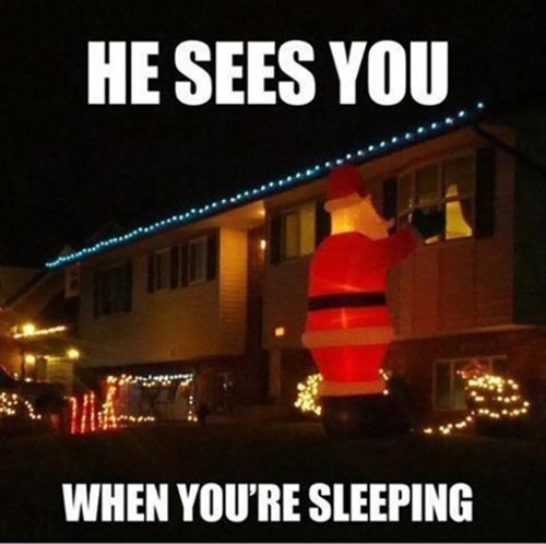 Giant inflatable Santa looking in a bedroom window