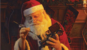 Santa Claus painting a toy train