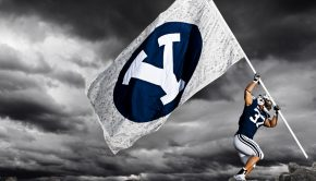 BYU football player raising flag