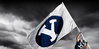 BYU football player raising flag