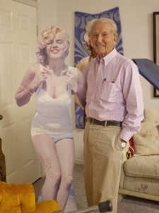 Dr. Roy Nisson, 94, poses with a cutout of Marilyn Monroe, one of his former dental patients. Image via Chris Caldwell.