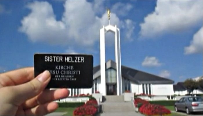 Hand holding up missionary name tag