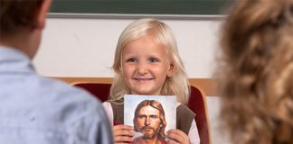Child shows a picture of Jesus
