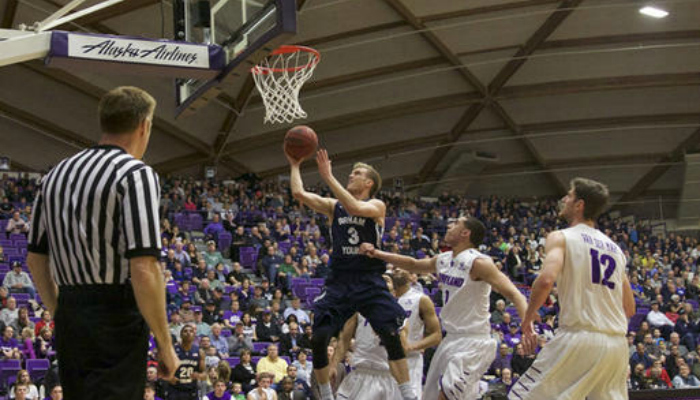 Tyler Haws making a layup against Portland